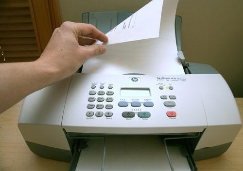 Lắp đúng mặt giấy khi bỏ giấy vào máy fax
